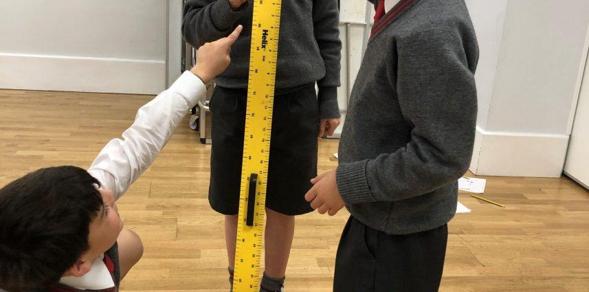 children using a giant ruler