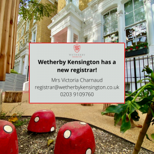 An anncoucement image of Wetherby Kensington's new registar, Mrs. Victoria Charnaud, set against a back drop of the front of a school with painted toadstools.